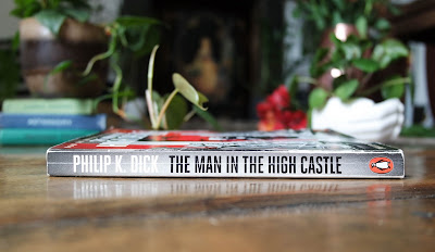 An image of the book the man in the high castle by phillip k dick on typewriter teeth laid flat so spine is visible