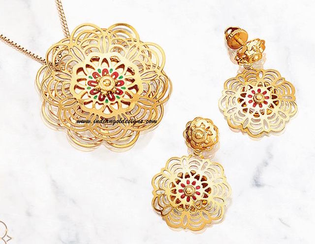 Gold and diamond jewellery designs march 2017 checkout tanishq amara collection 22k floral shaped pendan with gold chain and paired with matching earrings unique gold pendant set design from tanishq mozeypictures Image collections