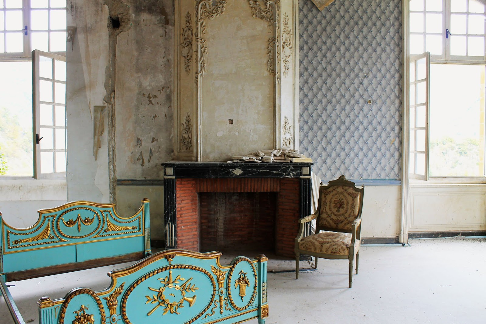 Fanciful blue and gilded gold bed in decaying room of Chateau de Gudanes