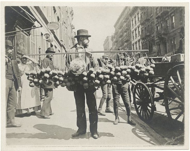 Vintage photo Street Vendor New York 1890s. A man offers balls of cheese tied to large pole. Jingles and other stories of The American Dream. marchmaton.com