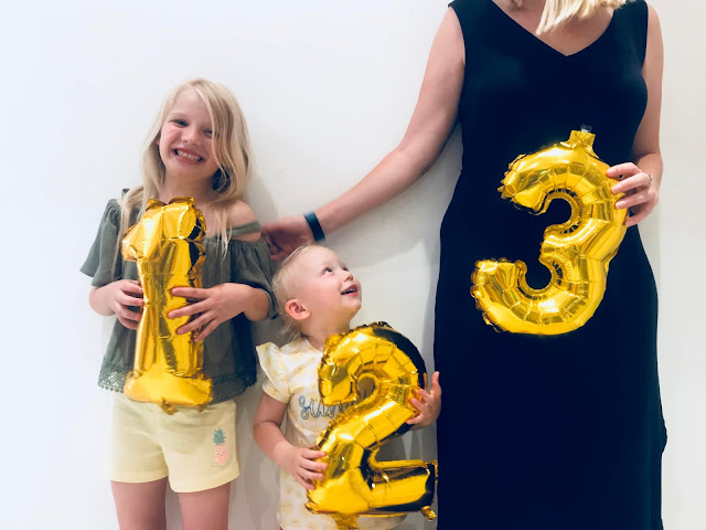 My pregnancy announcement for baby number 3 with numbered balloons