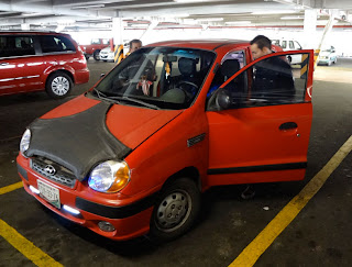 People getting into a Dodge Atos in Mexico
