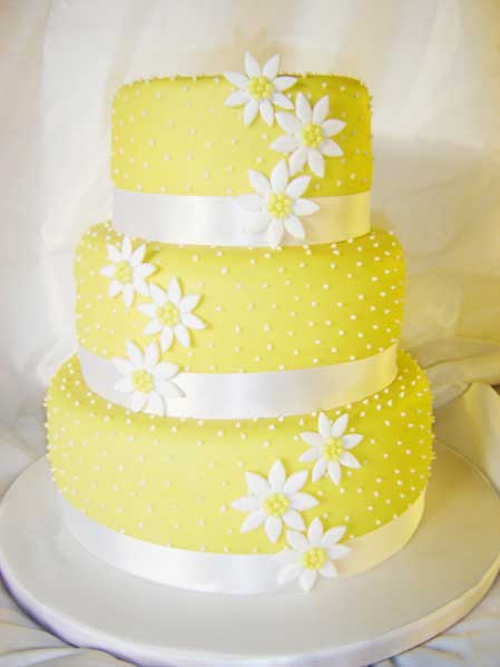 Wedding By Designs  Yellow Wedding Cakes Design Royal icing latticework gives this grand cake a summery feel  but the  year round appeal of citrus fruit makes it right for any season