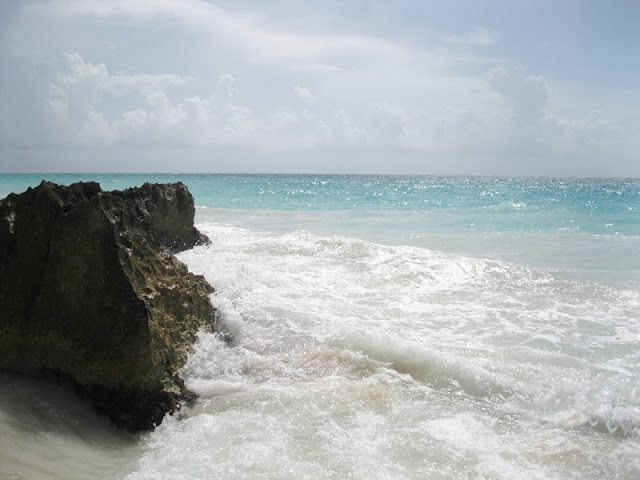 Waves hitting rock at Tulum Beach