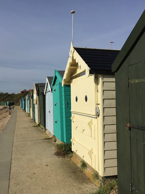 A row of beach huts on the promenade