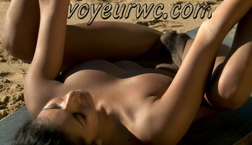 Nude Yoga Ocean - naturist yogini practicing yoga poses naked