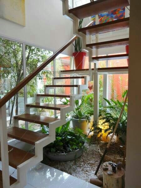 "The open space under your indoor stairs can be used in so many interesting ways. Like a beautiful small garden that will bring the nature in your home. And my ""48 Images of Indoor Staircase Open Space Garden Design Ideas"" collection will surely inspire you and help awaken your creativity to make your own garden ideas design."