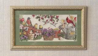 Вышивка птицы в саду