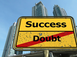 road sign reading success and doubt in a big city
