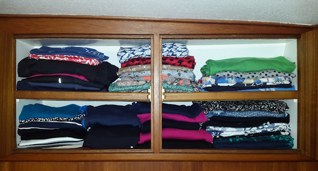 Photo of clothes in one of the lockers in our bedroom