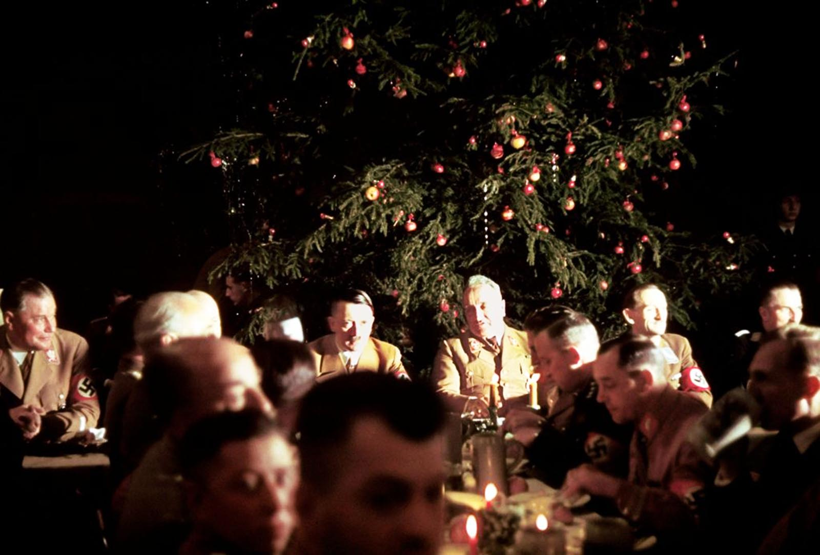 Adolf Hitler and other Nazi officials celebrate Christmas at the Lowenbraukeller restaurant in Munich.