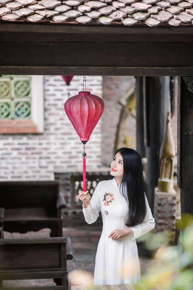Hoa khôi ĐH Tài Nguyên Môi trường thướt tha trong tà áo dài trắng - Ảnh 6