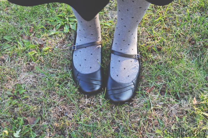 Payless black flat shoes and gray target tights with black polka dots.