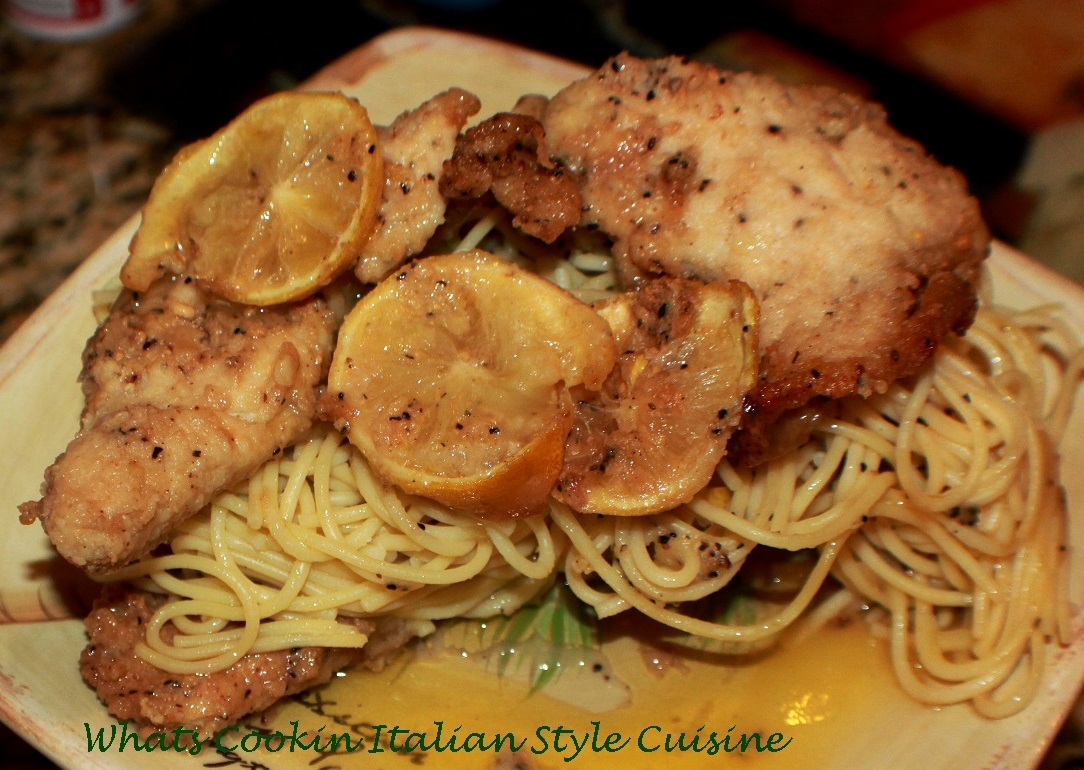 this is a lemon fried chicken with fresh lemons on a bed of linguine pasta. This is an easy quick meal that doesnt require much kitchen time or knowledge, This lemon chicken is a light summer meal