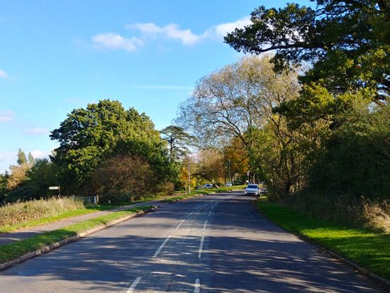 Photograph of Hawkshead Road approaching Folly Arch, Little Heath, October 2018 Image by the North Mymms History Project, released under Creative Commons