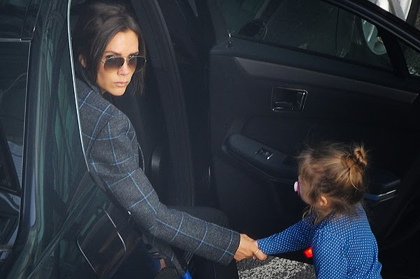 Victoria Beckhamand Baby Harper at London airport