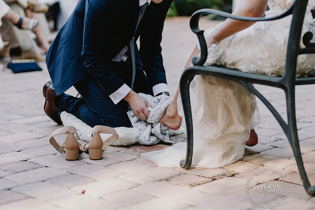 groom washing brides feet- ceremony