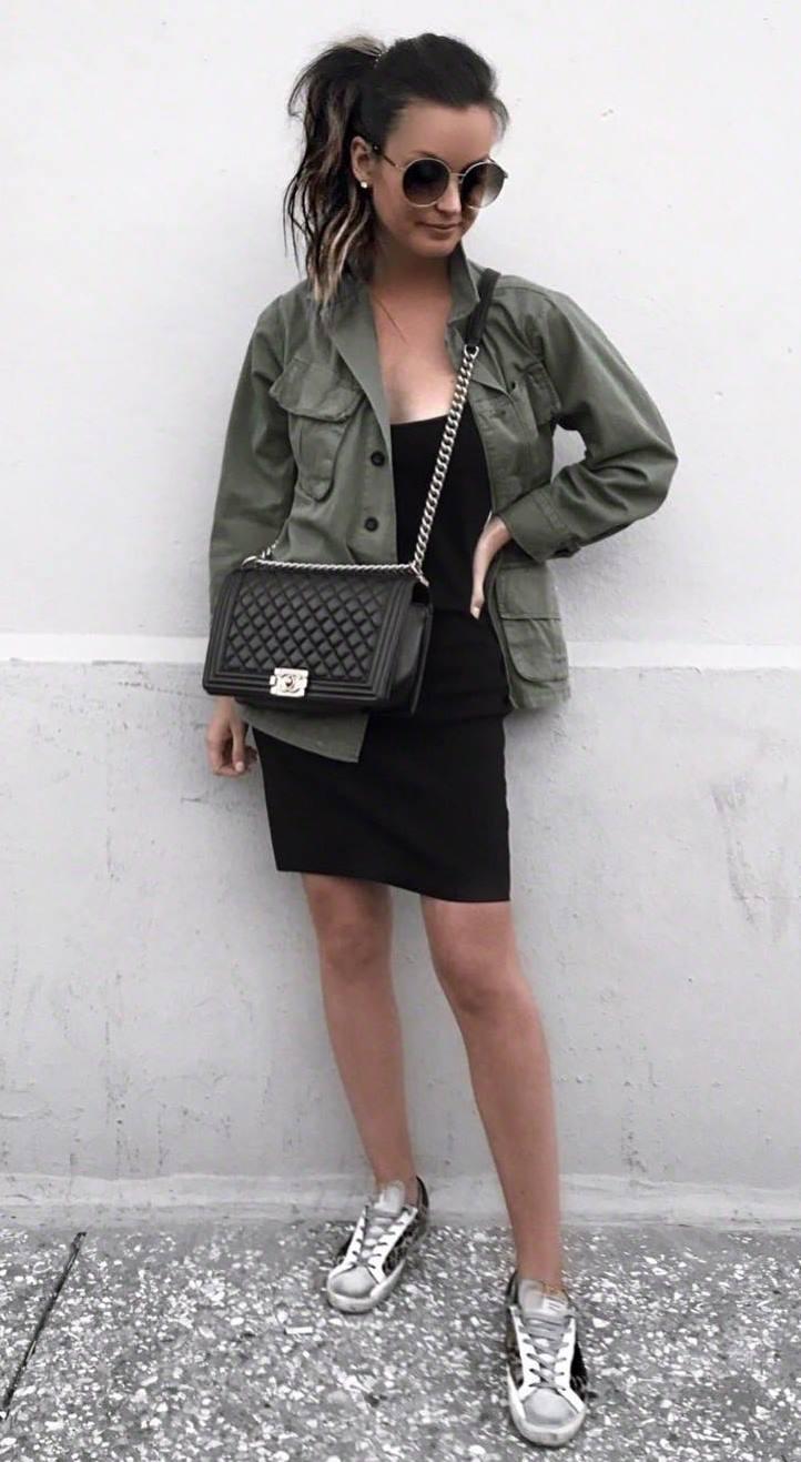how to wear a khaki jacket : black bodycon dress + crossbody bag + sneakers