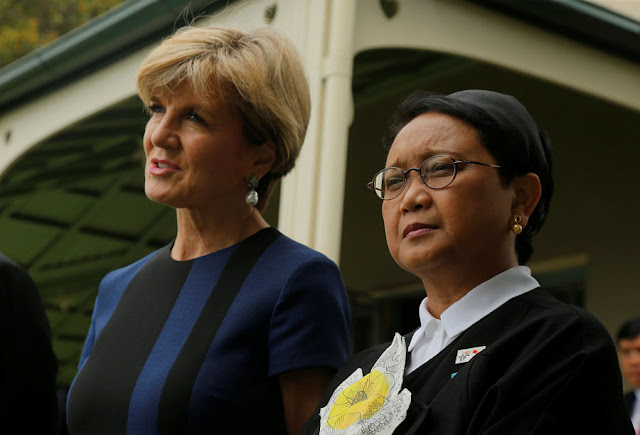 Image Attribute: Indonesian Foreign Minister Retno Marsudi (R) and her Australian counterpart Julie Bishop listen to remarks by President Joko Widodo and Australian Prime Minister Malcolm Turnbull (not pictured) at a press conference in Sydney, Australia, February 26, 2017.  REUTERS/Jason Reed
