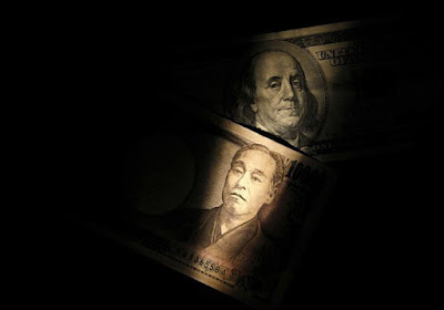 Light is cast on a U.S. one-hundred dollar bill next to a Japanese 10,000 yen note in this picture illustration