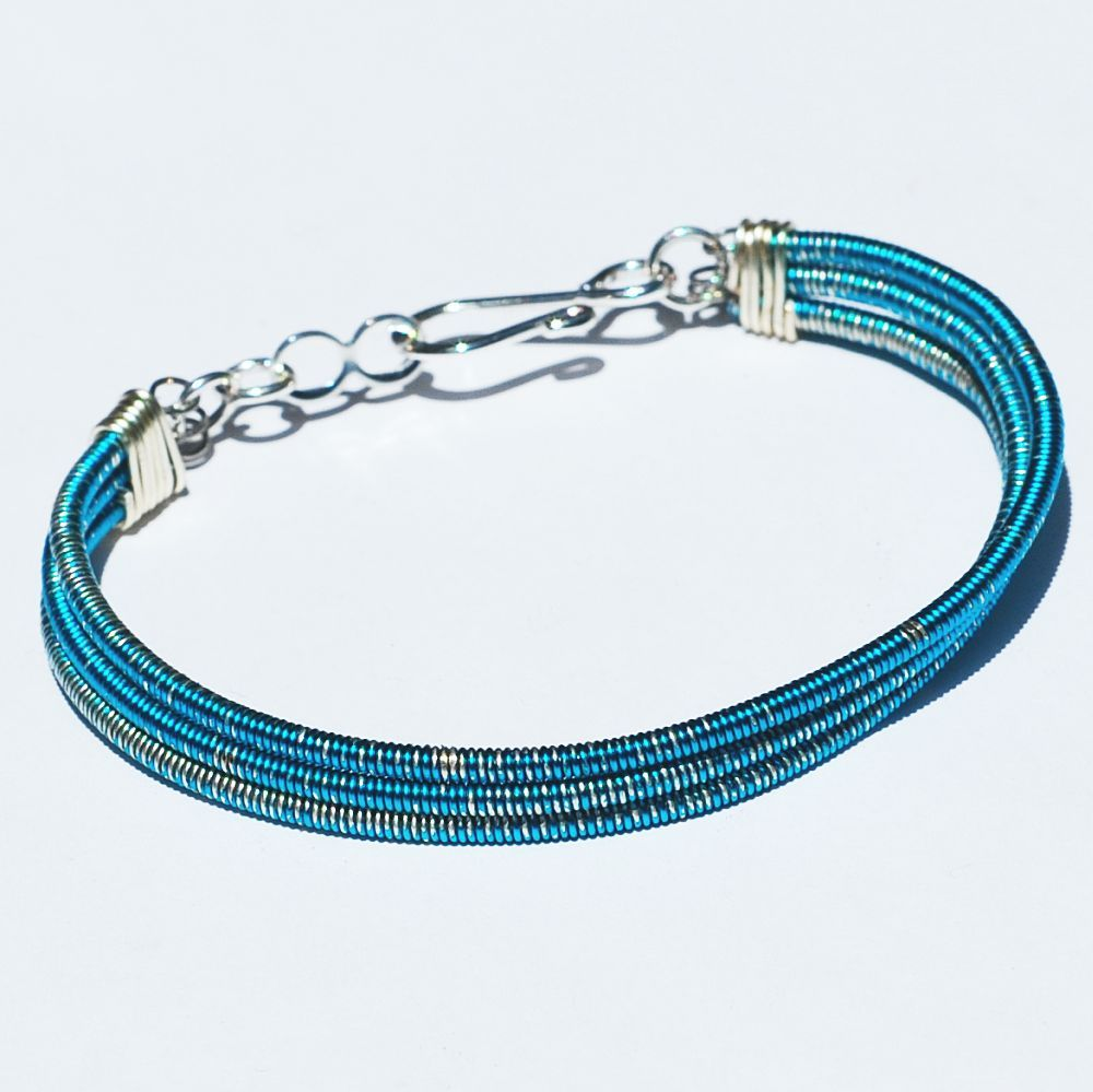 guitar string jewelry by tanith rohe bass guitar string bracelet 3 strand electric blue. Black Bedroom Furniture Sets. Home Design Ideas