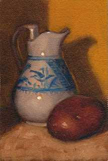 Oil painting of a white porcelain jug with blue designs beside a Désirée potato.