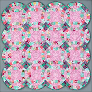 double wedding ring quilt 54 x 54 free pattern by marsha evans moore for free spirit fabric - Double Wedding Ring Quilt Pattern