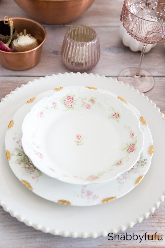 stack of plates with pink roses