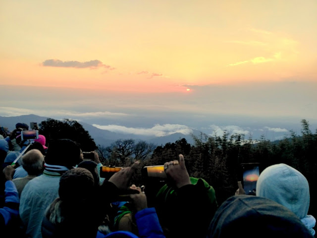 people capturing sunrise at tiger hill