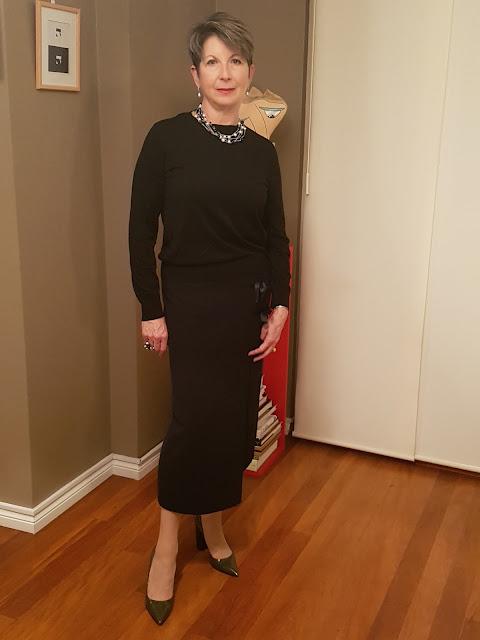 Black midi-skirt-black-cashmere sweater-long-black-coat-high-heel-shoes