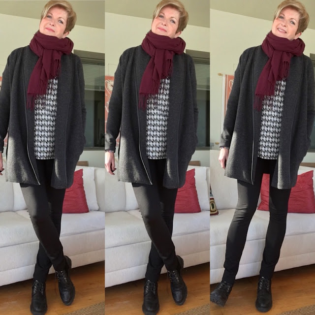 woman in black leggings, charcoal sweater, checkered tee and burgundy scarf