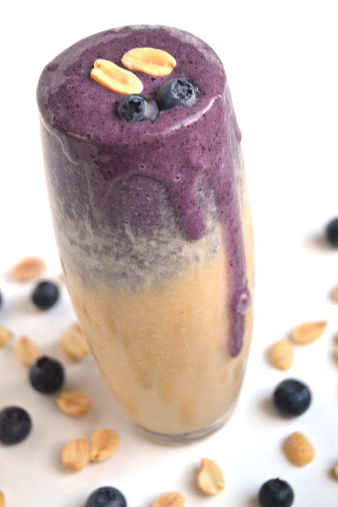 Peanut Butter and Jelly Smoothie looks beautiful in a glass with separate layers that taste like grape jelly and peanut butter! Use your choice of berries for different options. www.nutritionistreviews.com