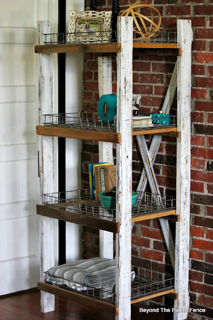 farmhouse decor, industrial shelf, rustic decor, exposed brick, wire baskets, thrift store find, DIY, http://goo.gl/CQsXQJ
