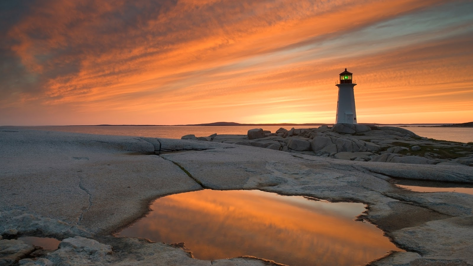 Peggy's Cove Lighthouse at dusk, Nova Scotia, Canada © Darwin Wiggett/Offset
