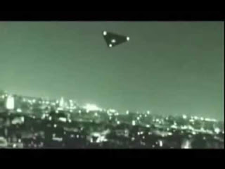 Image of the Navy's secret TR-3B UFO hovering over a city at night