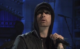 'Just retire into the trailer park': Eminem is SKEWERED on social media after his bizarre performance on SNL... which featured medley of old hits