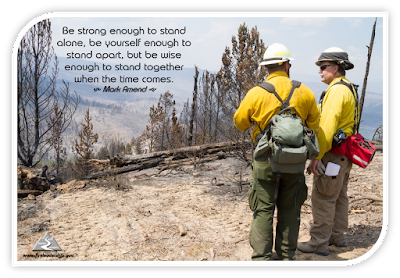 Be strong enough to stand alone, be yourself enough to stand apart, but be wise enough to stand together when the time comes. - Mark Amend [two wildland firefighters standing together atop a mountain range