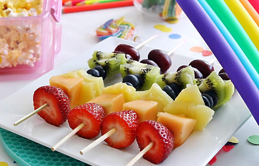Rainbow fruit skewers.