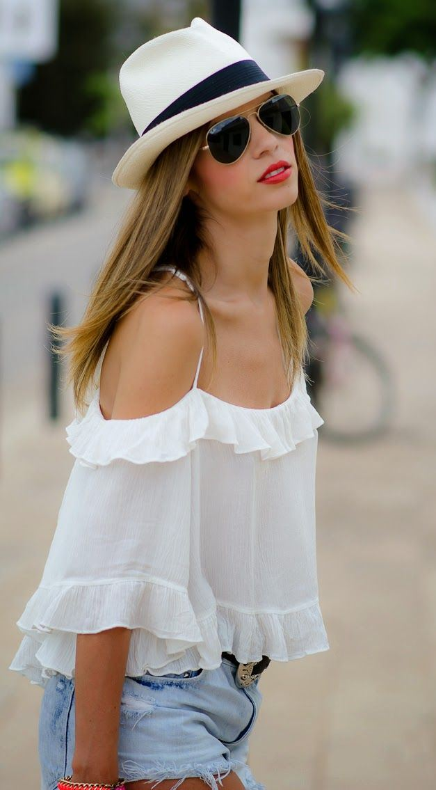 what to wear with a white blouse : hat + shorts + sunglasses