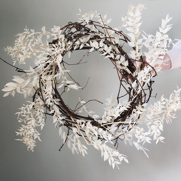 Natural white wreath with dried plants for simple Christmas decoration by kindred.blooms