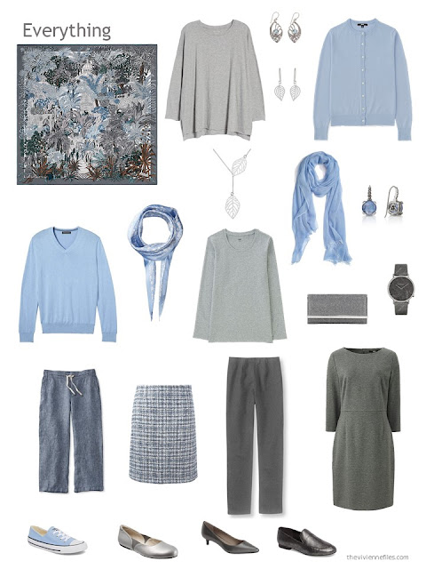 a capsule wardrobe in shades of grey with blue accents