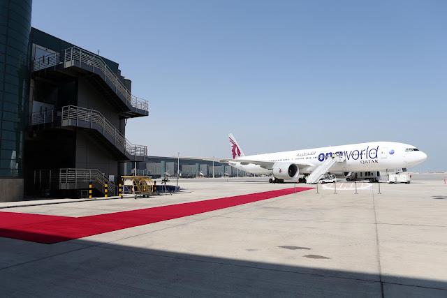 Qatar Airways in One World Alliance Logo and Boeing 777-300ER