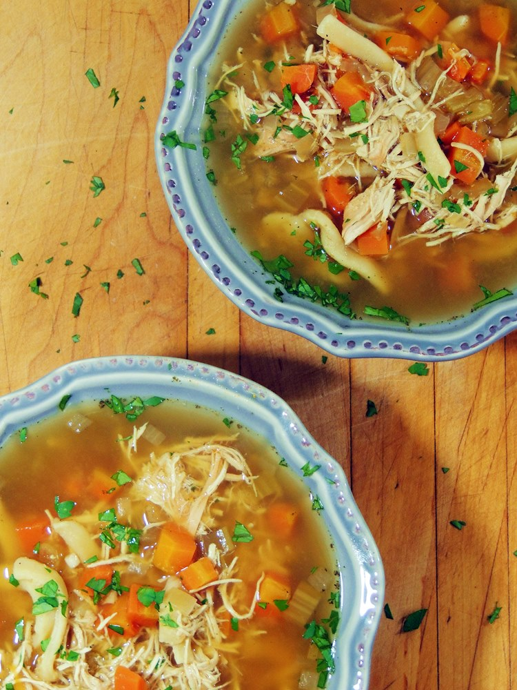 Slow Cooker Chicken Noodle Soup - Break out that slow cooker and make this soup ASAP!! It is, hands down, the best chicken noodle soup ever! From www.bobbiskozykitchen.com