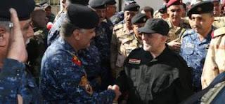 العبادي من الجانب الأيمن في الموصل يصدر توجيهات للقادة العسكريين