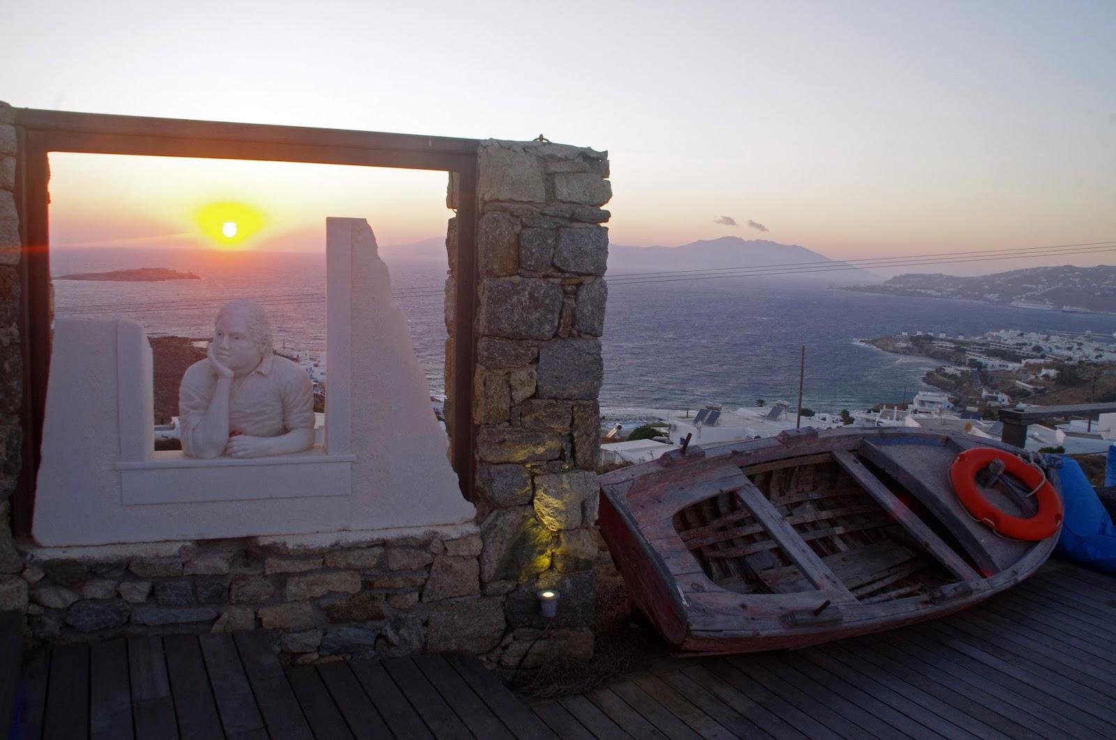 Tharroe of Mykonos Sunset over island