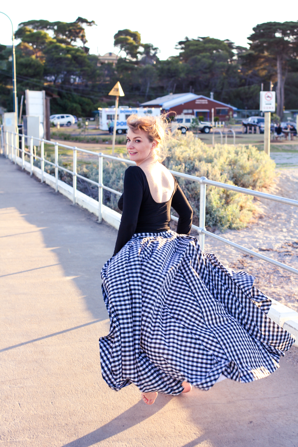 Liana of @findingfemme in Fame and Partners gingham skirt