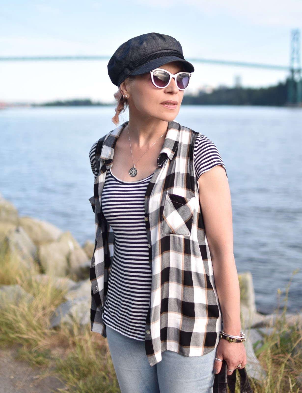 Monika Faulkner personal style inspiration - striped tee, plaid sleeveless shirt, white cat-eye sunglasses, baker boy cap