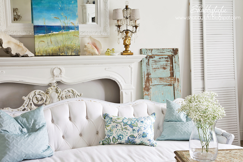 five minute styling tips - light blue and green accents in a white room with coastal artwork