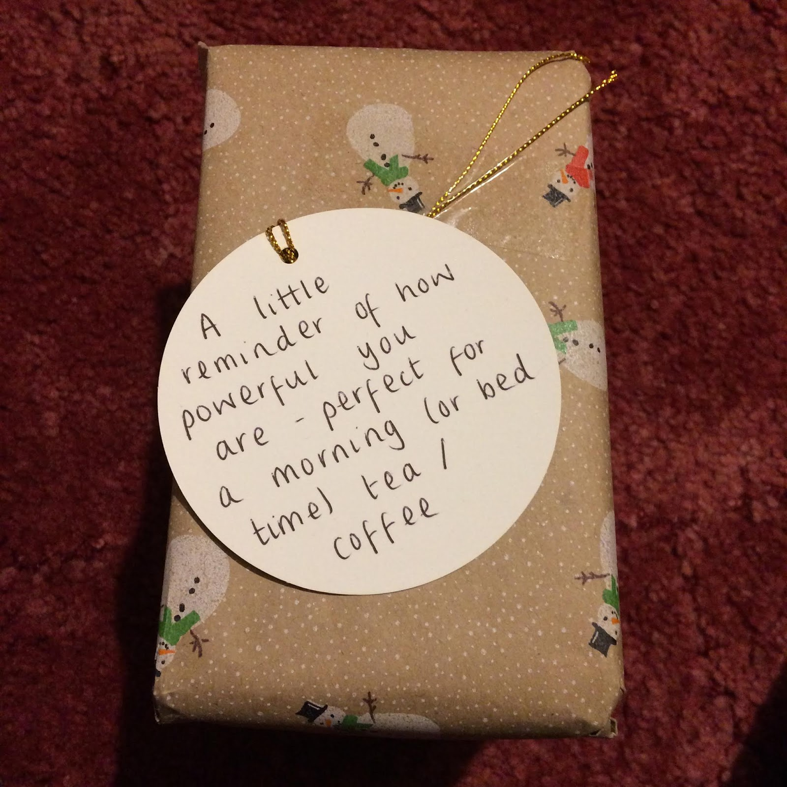 Wrapped present with tag reading, A little reminder of how powerful you are - perfect for a morning (or bed time) tea/coffee