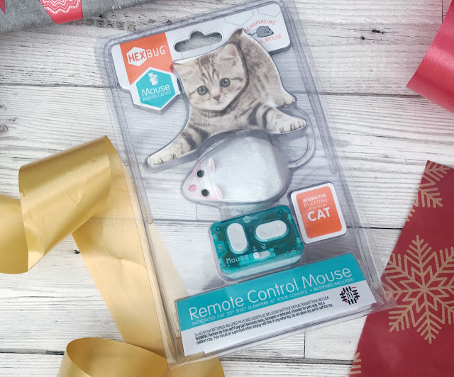 Hexbug Remote Control Cat in it's packaging surrounded by wrapping paper and ribbon